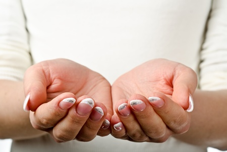 Female hands cupped. Ready to hold object photo