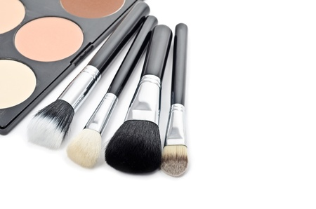 neutrals: Professional multi colored make-up and brushes Stock Photo