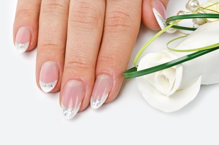french manicure sexy woman: Female hands with perfect manicure and flowers