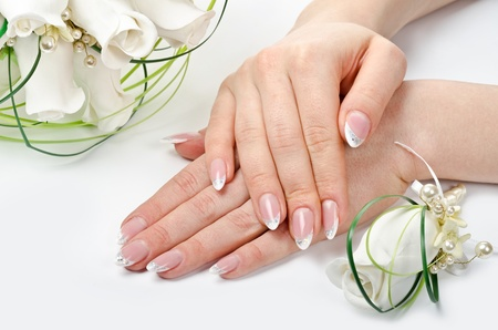 french woman: Female hands with perfect manicure and flowers - beauty treatment