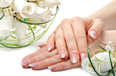 Female hands with perfect manicure and flowers - beauty treatment photo