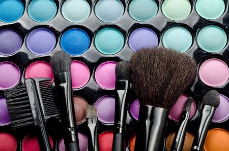 Professional multi colored make-up and brushes photo