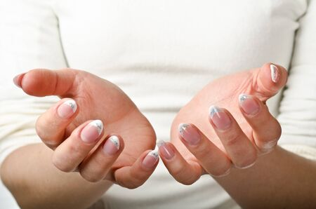 Female hands cupped. Ready to hold object Stock Photo - 13425043