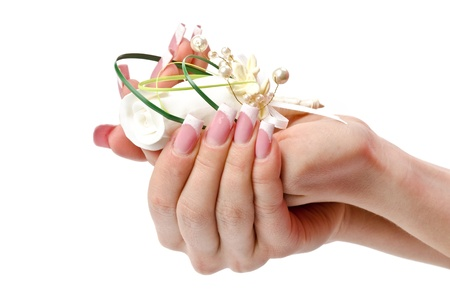 french manicure sexy woman: Female hands with perfect manicure and flowers - beauty treatment