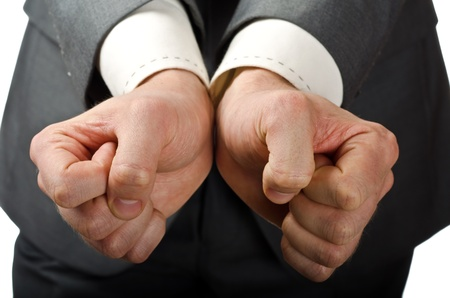 Business man being handcuffed, only hands visible photo