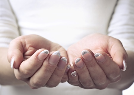 Female hands cupped. Ready to hold object Stock Photo - 13425014
