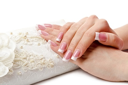 manicure salon: Perfect manicure on female hands. White background Stock Photo