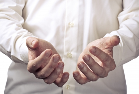 Businessman hands as if holding something. Focus on finger-tips photo