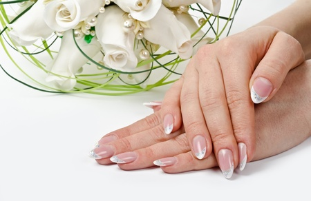Female hands with perfect manicure and flowers - beauty treatment Stock Photo - 14265558