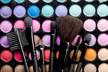 make up products: Professional multi colored make-up and brushes Stock Photo