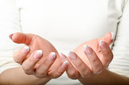 Female hands cupped. Ready to hold object Stock Photo - 14265538