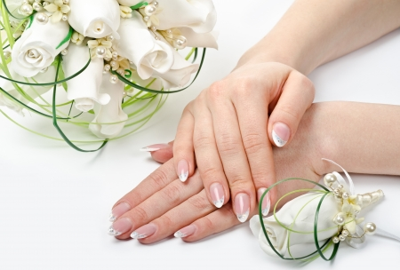 Female hands with perfect manicure and flowers - beauty treatment Stock Photo - 14265545