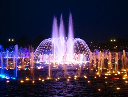 Night fountain with multi-coloured illumination