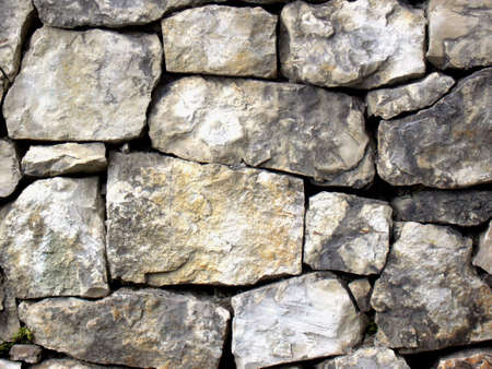 Old wall constructed of grey stones