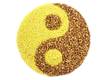 millet: Yin and yang drawn by means of millet and buckwheat grains Stock Photo
