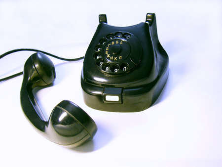 The black retro phone with the removed receiver on white Stock Photo