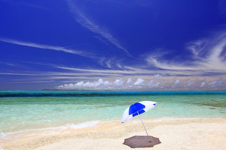 The beach and the beach umbrella of midsummer  photo