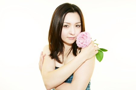 A woman with a Roses flower  photo