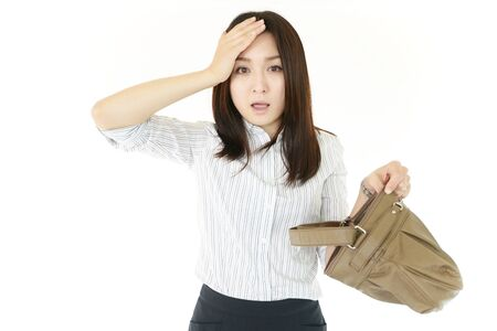 Woman with a bag of uneasy look Stock Photo - 14878612