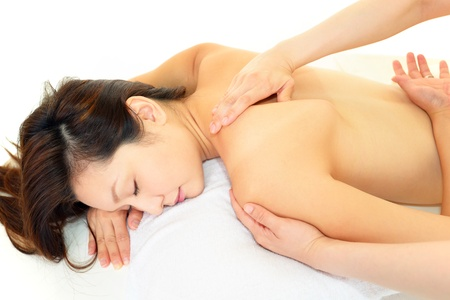 The woman who receives body massage  Stock Photo
