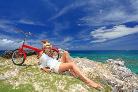 Girl Riding a Bike on the Beach photo
