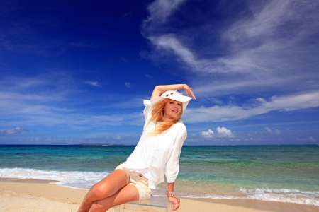 The woman who relaxes on the beach  photo