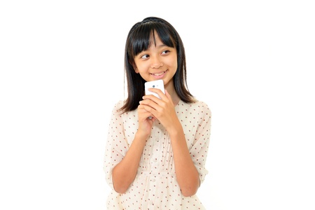 The girl who watches the screen of the smart phone happily Stock Photo - 14867830