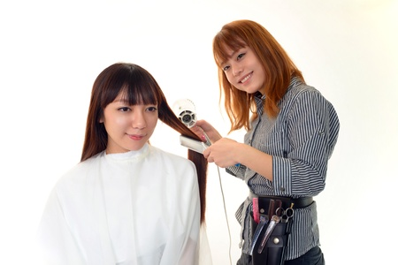 Portrait of an Asian hairdresser photo
