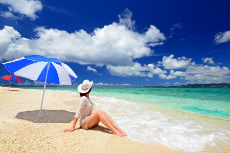 relaxes: The woman who relaxes on the beach