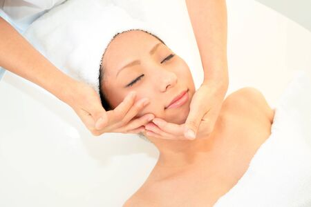 Pretty woman receiving facial massage photo
