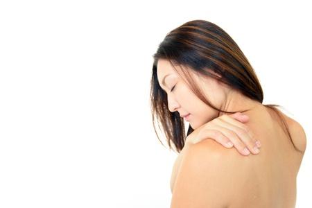 La mujer que est� preocupada con hombro r�gido Foto de archivo