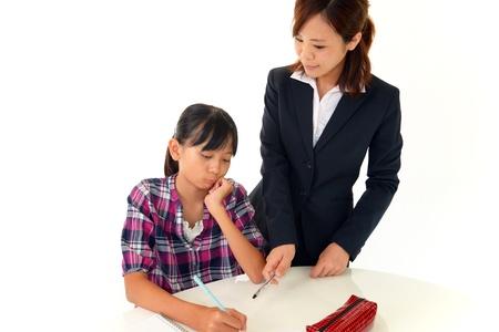 atilde: Child Studying Stock Photo