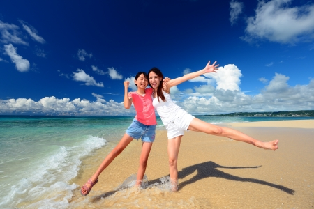 Family playing on the beach in Okinawa Stock Photo - 15009829
