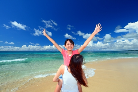 Family playing on the beach in Okinawa photo