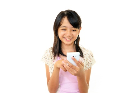 happy young girl holding mobile phone  photo