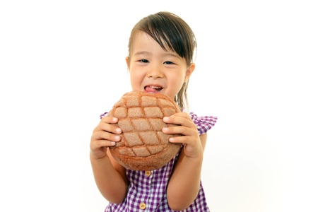 comiendo pan: Ni�a comiendo pan Foto de archivo