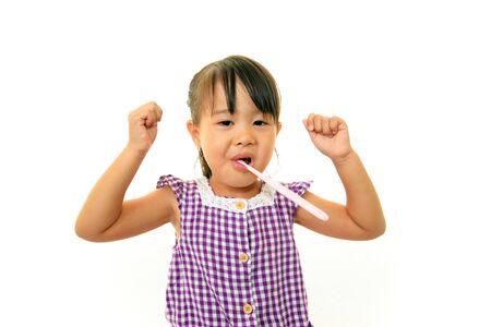 Happy little Asian girl smile photo