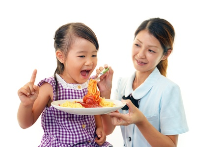 Child eating spaghetti Stock Photo - 15339177
