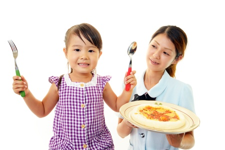 Child eating pizza photo
