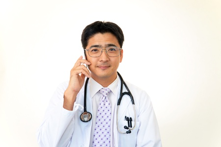Smiling asian medical doctor Stock Photo - 15339482