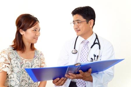 幸せな医師と患者 写真素材