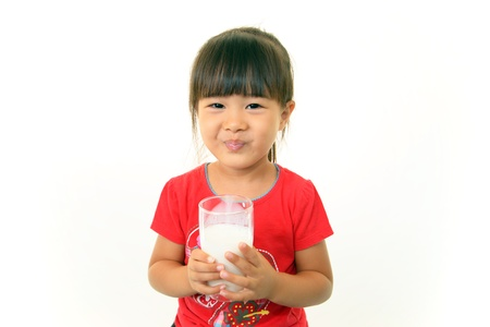 Girl drinking milk photo