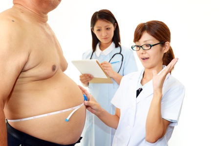 Physician with an examination of obese patients Stock Photo - 15585636
