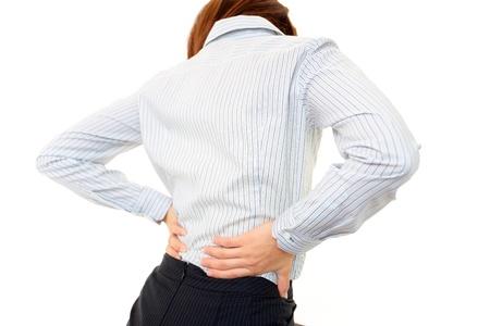 back of woman: Mujer del dolor de espalda Foto de archivo