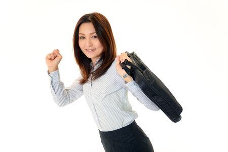 iuml: Smiling young woman holding a shoulder bag