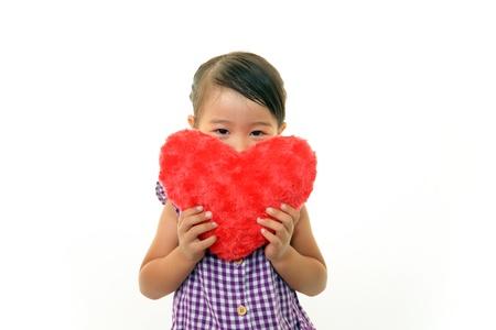 Joyful little girl holding present in hands