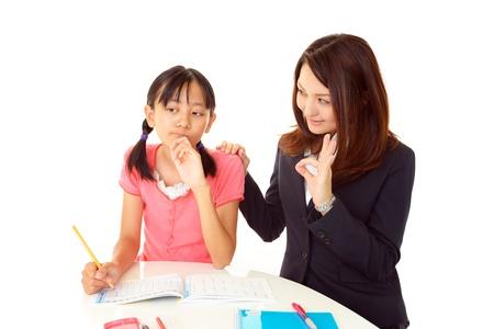 schoolroom: Girls look uneasy Stock Photo