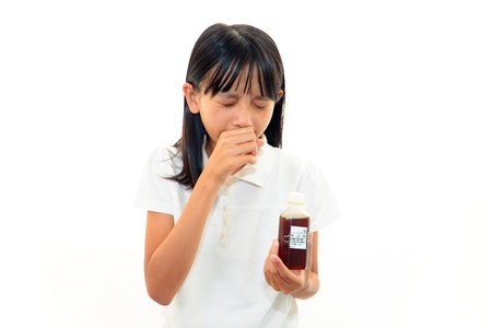 cough medicine: Girl with a bad cold Stock Photo
