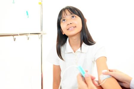 enteritis: Child hand with IV