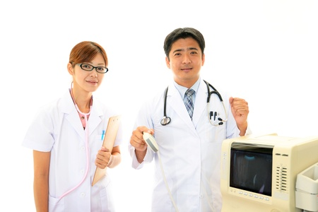 Smiling asian medical doctors Stock Photo - 15647782